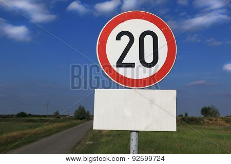 Twenty miles per hour speed limit sign against a partly cloudy sky