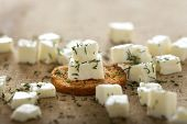 stock photo of antipasto  - Close up of one antipasto with cheese and dill over wood background  - JPG