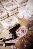 stock photo of drug dealer  - Drug packages raw opium drug dozens and weapons seized by police - JPG