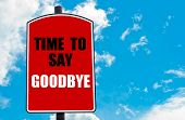 image of goodbye  - Time To Say Goodbye motivational quote written on red road sign isolated over clear blue sky background - JPG