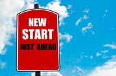 foto of start over  - New Start Just Ahead motivational quote written on red road sign isolated over clear blue sky background - JPG
