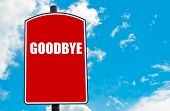 picture of goodbye  - Goodbye written on red road sign isolated over clear blue sky background - JPG
