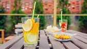 image of infusion  - Infused fruit water cocktails and green vegetable smoothies over a wooden table outdoors - JPG