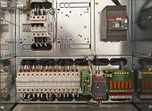 picture of contactor  - Electrical control cubicle with electrical devices closeup - JPG
