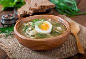 picture of sorrel  - Green soup of sorrel in wooden  bowl - JPG