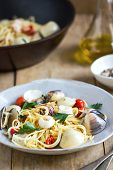 stock photo of clam  - Spaghetti with squid clam and prawn by sea salt