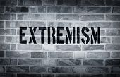 stock photo of isis  - Extremism stencil print on the grunge white brick wall - JPG