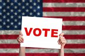 picture of voting  - Vote card with USA flag background - JPG