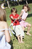 picture of tug-of-war  - Children Playing Tug Of War - JPG