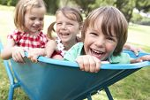 picture of three sisters  - Three Children Sitting In Wheelbarrow - JPG