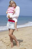 foto of cuddle  - Mother Cuddling Young Daughter outdoors - JPG