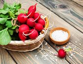 picture of radish  - Fresh organic radish on a old wooden background - JPG