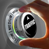 pic of assemblage  - Hand rotating a button and selecting the level of traffic - JPG