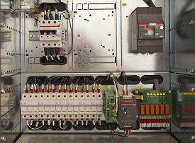 stock photo of electric station  - Electrical control cubicle with electrical devices closeup - JPG
