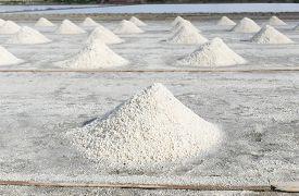 image of triangular pyramids  - Row of salt in Salt pan in Thailand - JPG