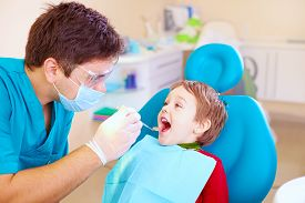 image of dislike  - small kid patient visiting specialist in dental clinic - JPG