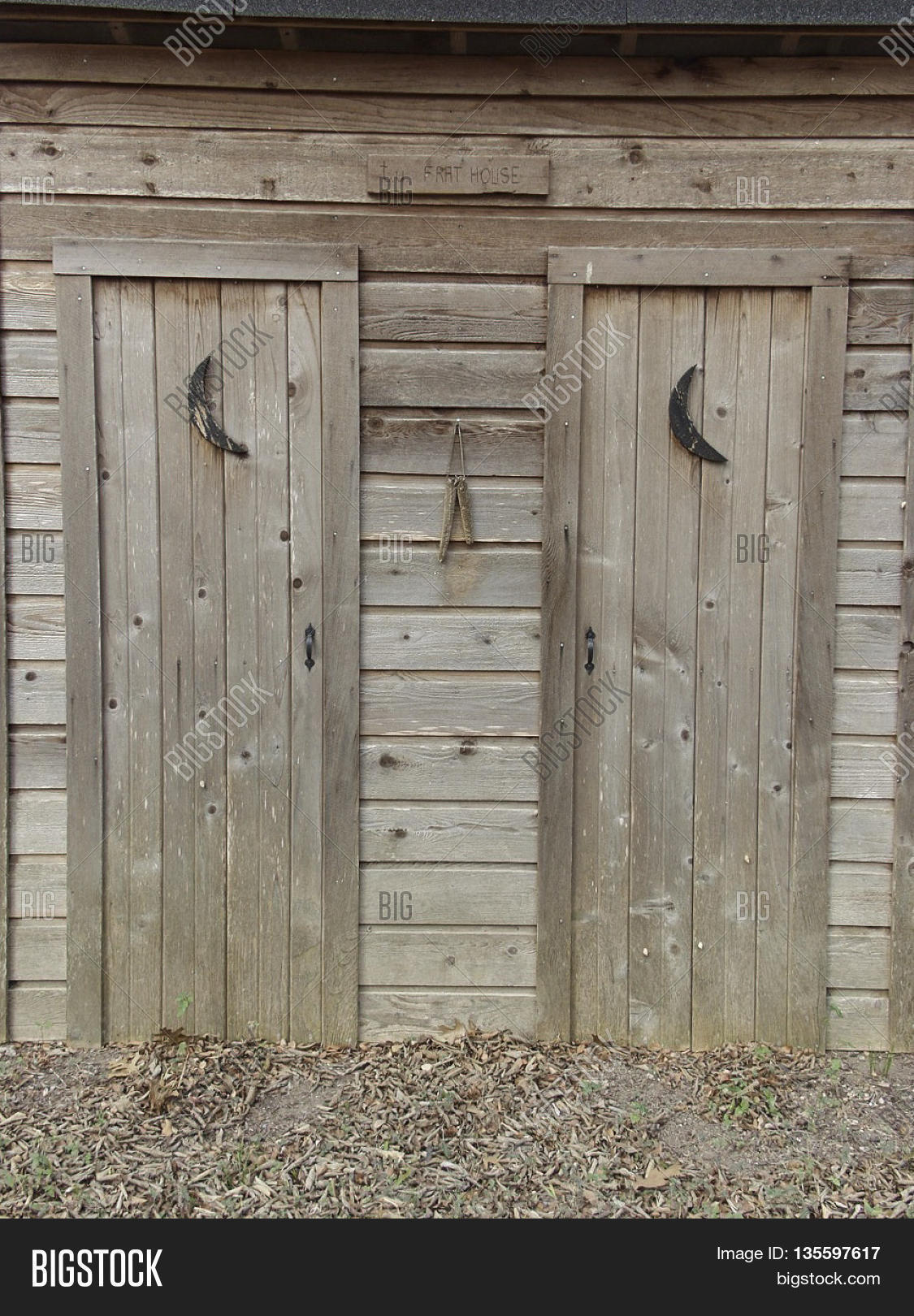 Two old outhouse doors side-by-side in a small town. & Two old outhouse doors side-by-side in a small town. Stock Photo ... Pezcame.Com