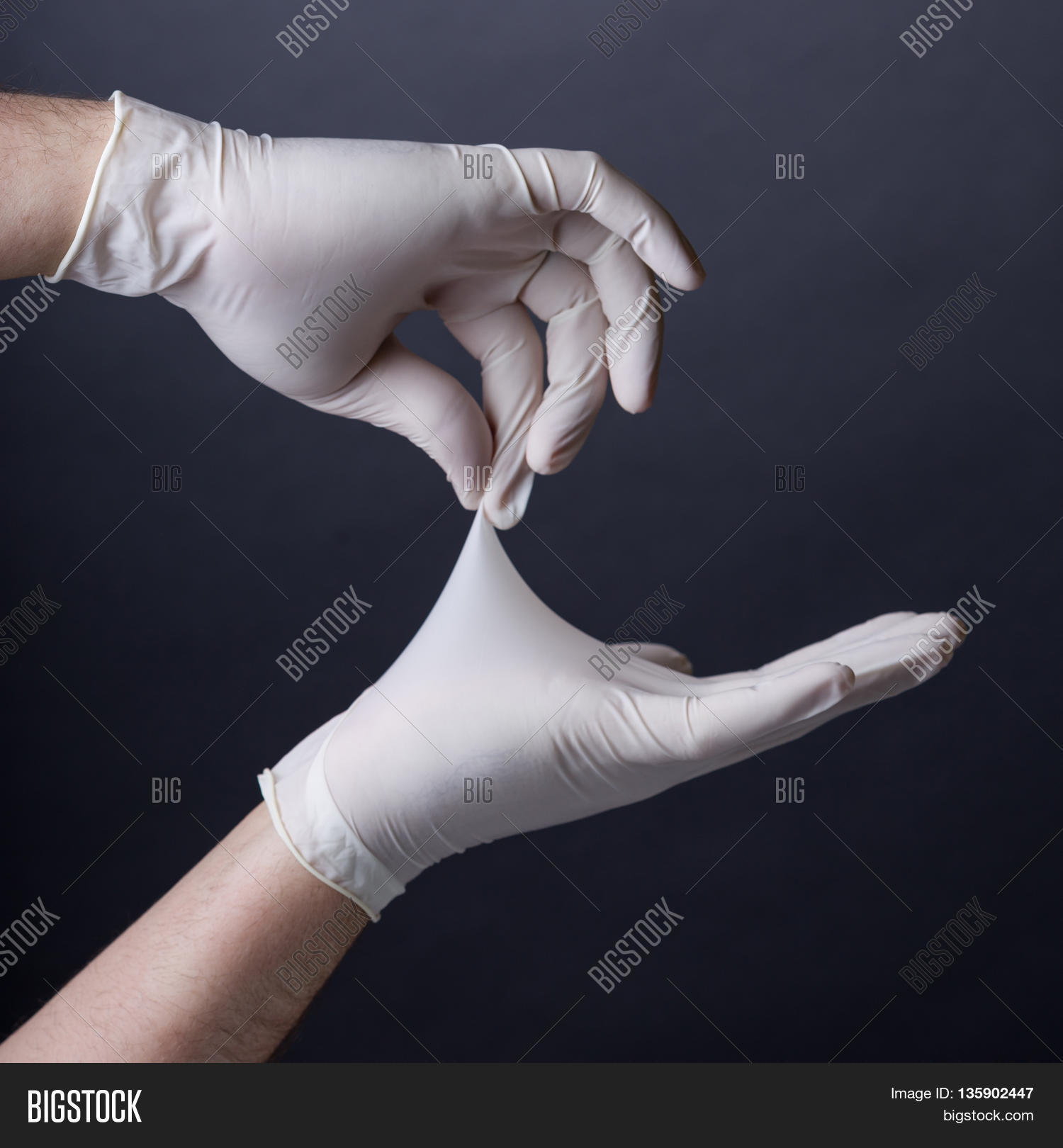 Doctor putting hand in male ass