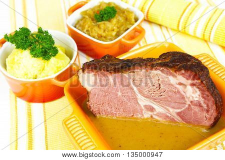 a Pickled cabbage potatoes and Kasseler meat