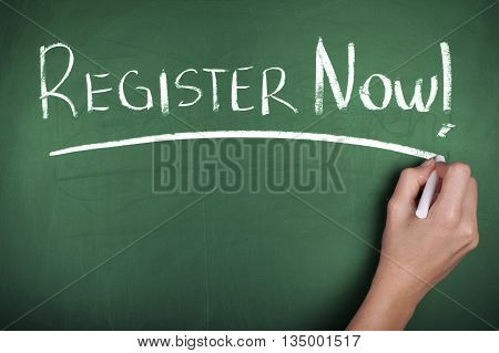 Hand writing register now note on chalkboard