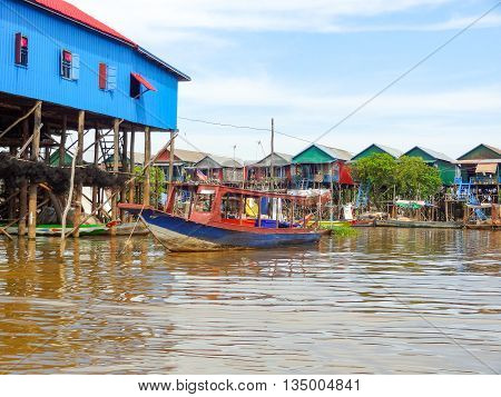 traditional settlement with wooden houses at the Tonle Sap river in Cambodia