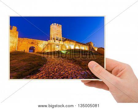Hand and Kalemegdan fortress Belgrade - Serbia (my photo) isolated on white background