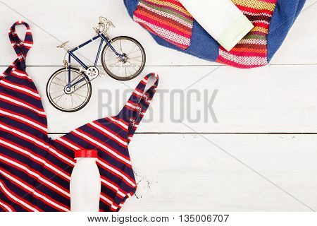 Bicycle Model, Striped Backpack, Swimsuit, Sunscreen, Bottle Of Water And Centimeter Tape