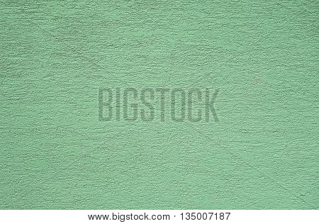 slightly green grooved plaster as a background