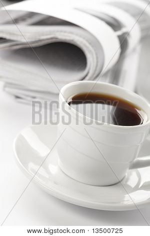 Cup of fragrant coffee on a morning paper business news