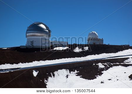 Observatory domes at the peak of Mauna Kea volcano Maui Hawaii islands