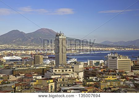 City of Naples with skyscraper harbor and Mount Vesuvius on the background