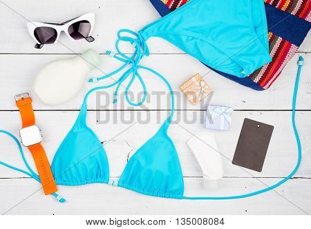 Summer Women's Fashion With Blue Swimsuit, Bag, Sunglasses, Sunscreen, Watch, Gift Boxes And Tag On