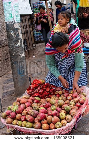 CUSCO PERU - CIRCA MARCH 2015: Unidentified people at the market in Cusco Peru