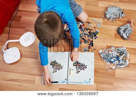 Little Boy Collects Children's Plastic Building Kit