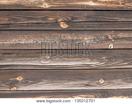 Dark braun old wooden background with horizontal boards