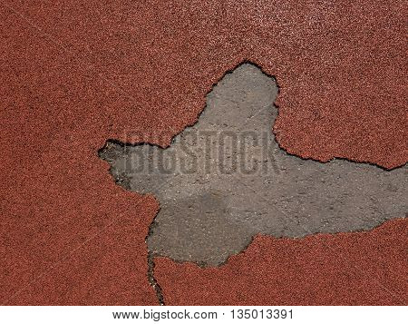 Damaged protective rubber coating in children playground. Texture background