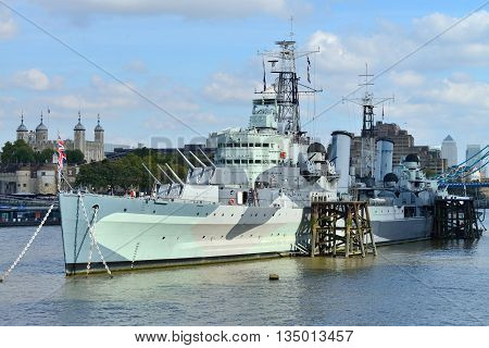 LONDON - OCTOBER 03: HMS Belfast (Royal Navy light cruise) on October 03 2014 in London UK. Belfast moored in London on River Thames and operated by the Imperial War Museum.