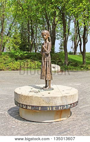UKRAINE, KYIV - MAY 01, 2013: Hungry girl bronze monument is a monument to Victims of Famine devoted to genocide victims of the Ukrainian people of 1932-1933 years, Kyiv, Ukraine