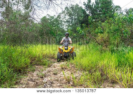 Man In Nature Enjoying A Off Road Quad Bike