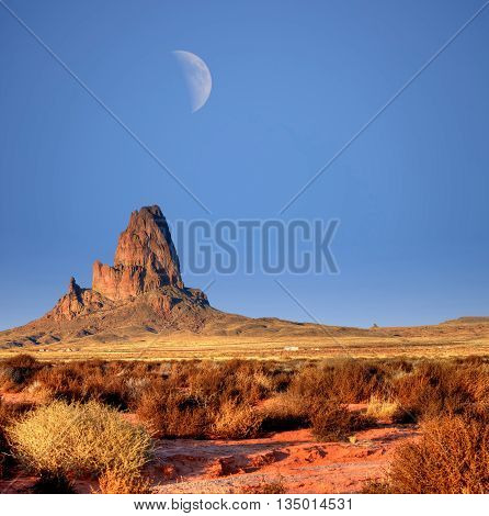 Half Large moon over Monument Valley Arizona