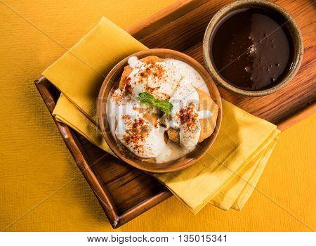 indian dahi vada or dahi bhalla, served in ceramic bowl
