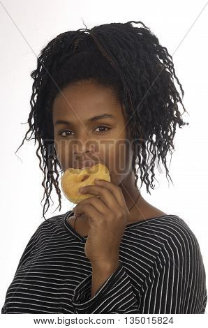 Teenager girl eating a donut on white background