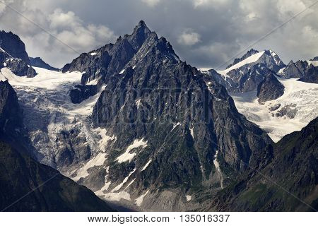 Mountains With Glacier In Clouds Before Rain