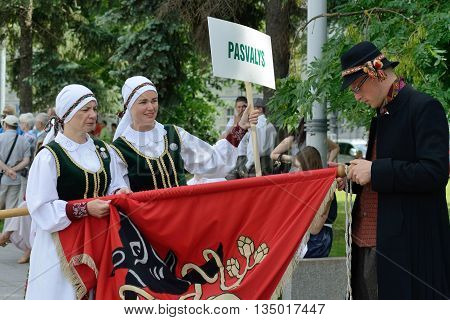 VILNIUS, LITHUANIA - JULY 6: Unidentified peoples in traditional Lithuanian Song Celebration on July 6, 2014 in Vilnius, Lithuania. Song Festival is Lithuania's main cultural event for 2014.