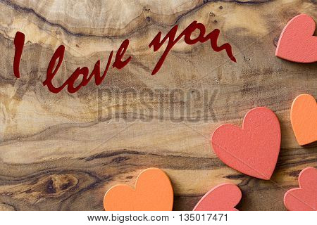 olive wood with wooden hearts and I love you written to celebrate love