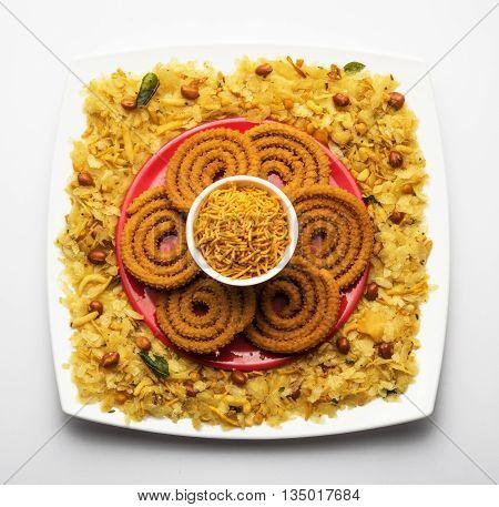 design created using diwali food or diwali snacks, chivda or chiwda, chakali or chakli, besan sev, front angle closeup