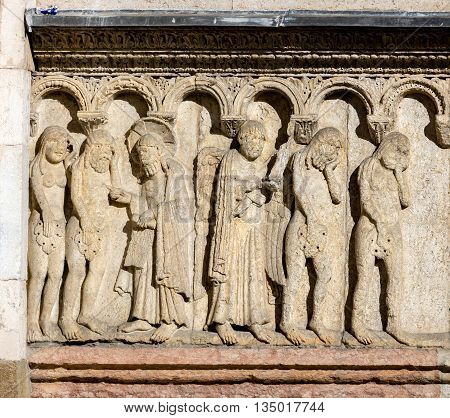 11th century carving of the Creation and Fall on the Modena's Cathedral facade. The figures are carved in high relief giving them a strong sense of three-dimensionality.