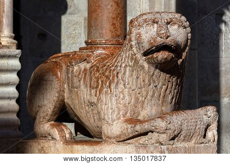 Medieval statue of a lion on the south-eastern side of the Modena's cathedral a UNESCO World Heritage Site in Modena Italy