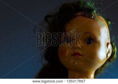 head of beatiful scary doll like from horror movie - evil face grunge macro