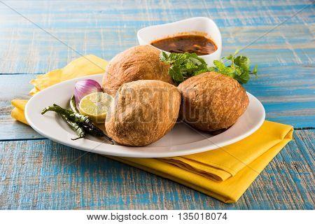 Kachori or Kachauri or Kachodi or Katchuri is a spicy snack popular in india, asian snacks, pakistani snacks with green salad